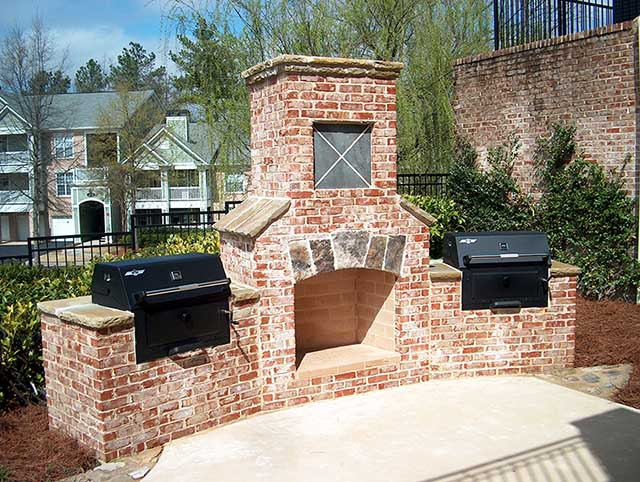 outdoor brick fireplace with grill